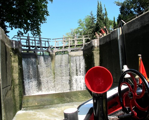 Passing through the lock on Tango Barge - Canal du Midi © Barge Vacations